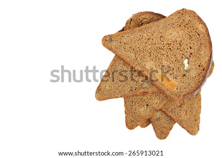 sliced bread dessert with dried apricots, raisins and walnuts - stock photo