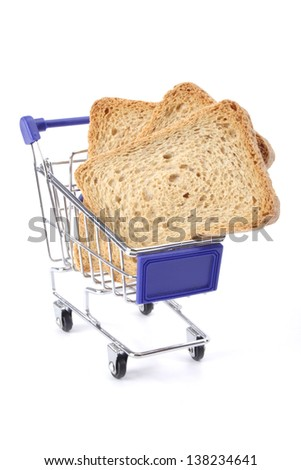 Sliced bread in shopping cart close up on white background - stock photo