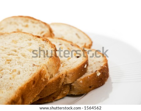 Sliced bread on plate.  Isolated on white. - stock photo