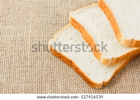 sliced bread on sacking background