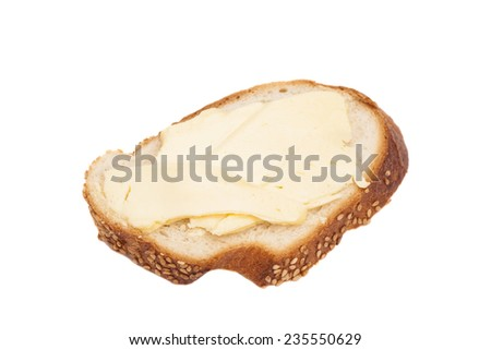 Sliced bread with butter isolated on white  - stock photo