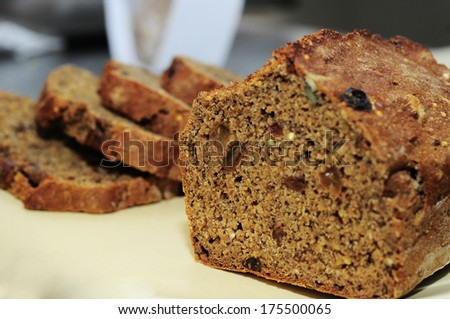 Sliced bread with cereals on the board, still life