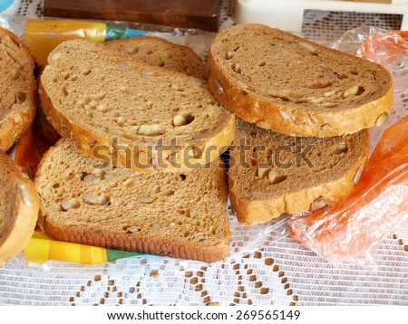 Sliced bread with nuts and seeds close up        - stock photo