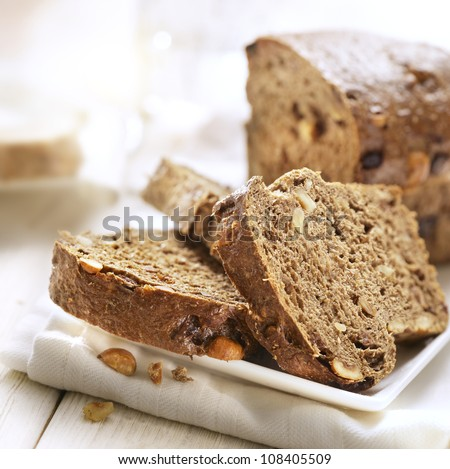 Sliced bread with nuts on a plate - stock photo