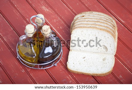 Sliced bread with oil and vinegar - stock photo