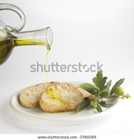 sliced bread with olive oil - stock photo