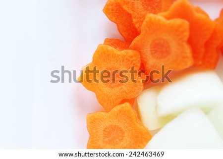 sliced carrot in flower shape - stock photo
