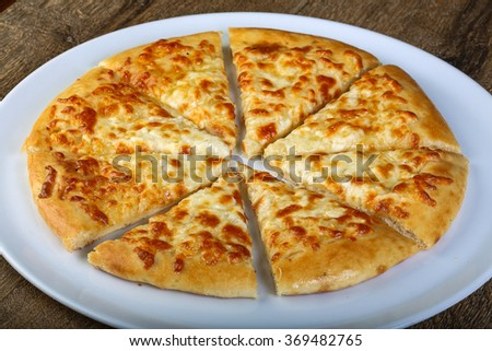 Sliced Cheese bread in the white plate