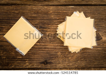 Sliced Cheese on a vintage background as detailed close-up shot (selective focus)