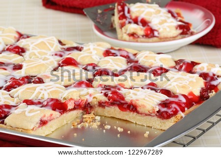 Sliced cherry bar dessert on a baking sheet - stock photo