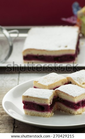 Sliced cherry pie squares on white plate