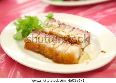 Sliced Chinese boneless roast pork with crispy skin - stock photo