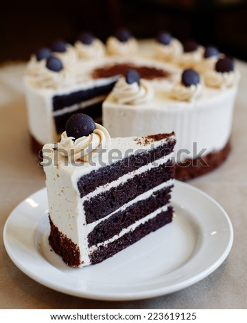 Sliced Chocolate Layer Cake with White Frosting - stock photo