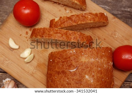 sliced ciabatta on a wooden background