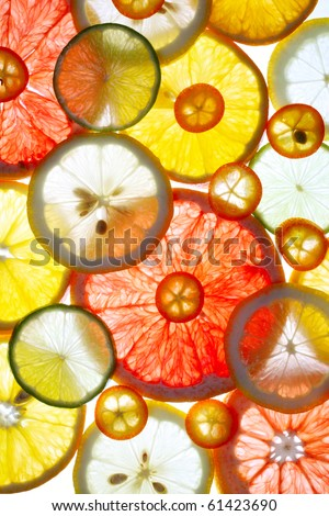 Sliced citrus fruits background - stock photo