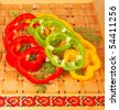 Sliced colorful paprika with dill on tray - stock photo