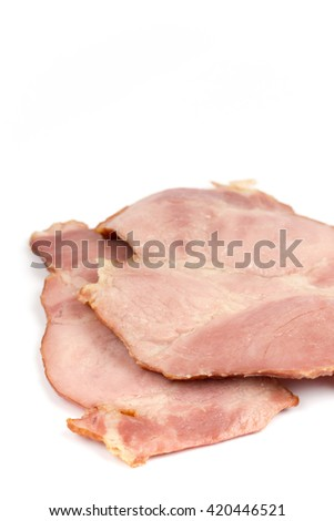 Sliced cooked smoked ham over white.