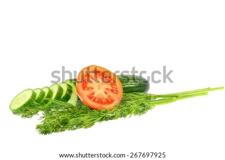 Sliced cucumber into slices next half tomato and dill on a white background - stock photo