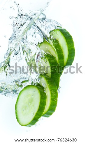 sliced cucumber splashing water isolated on white background