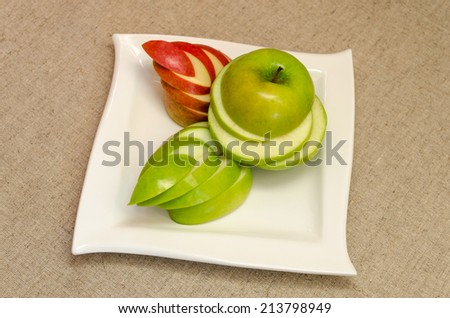 Sliced delicious apples on a white plate - stock photo