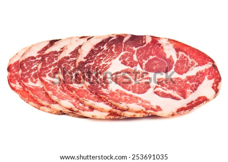 sliced delicious italian meat on white background - stock photo