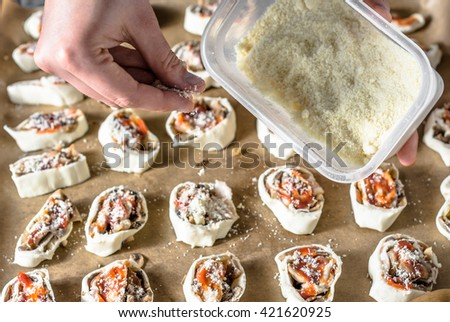 Sliced dough with filling, preparing puff pastry buns snacks, cooking concept