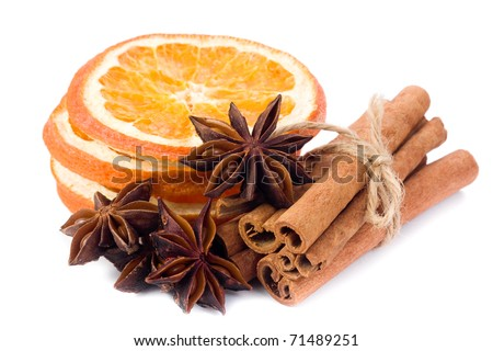 Sliced dried orange with cinnamon sticks and anise