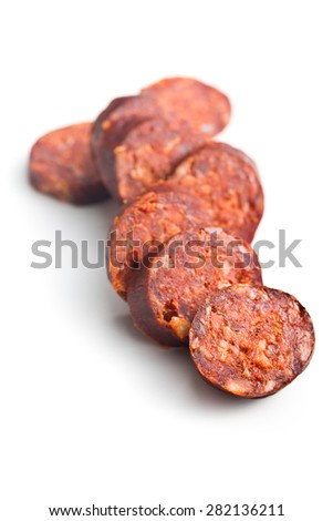 sliced dried sausages on white background - stock photo