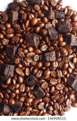 Sliced dry chicory root  and coffee beans  - stock photo