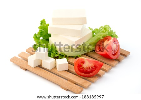 Sliced feta cheese with salad and tomatoes