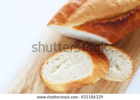 Sliced French bread on wooden board in diorama - stock photo