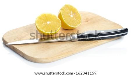 Sliced fresh lemon over chopping board - stock photo