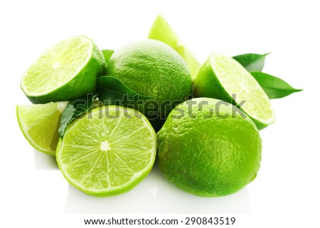 Sliced fresh limes isolated on white - stock photo