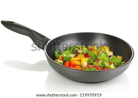 Sliced fresh vegetables in pan isolated on white - stock photo