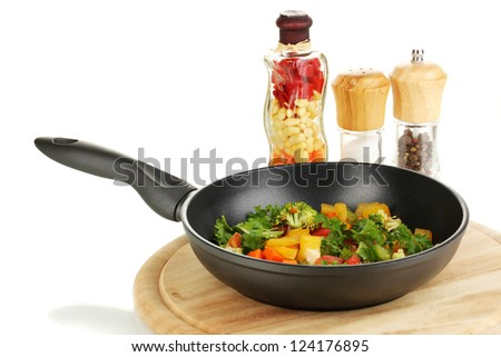 Sliced fresh vegetables in pan with spices isolated on white - stock photo
