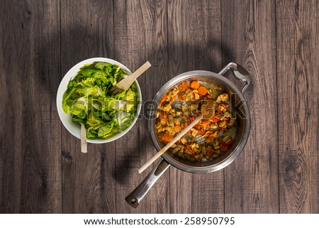 Sliced fresh vegetables with meat in pan - stock photo
