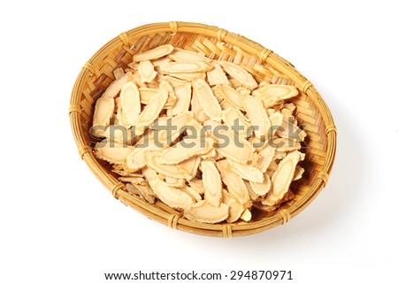Sliced ginseng in bamboo basket - stock photo