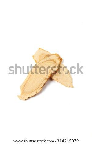 Sliced ginseng  on white background      - stock photo