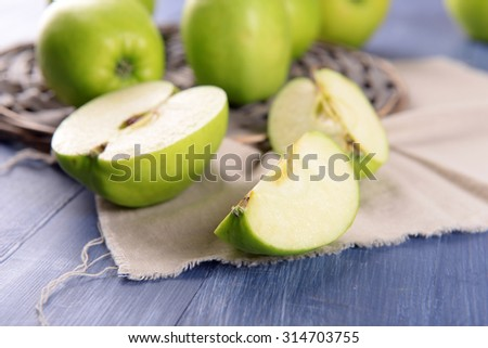 Sliced green apple on wooden table, closeup