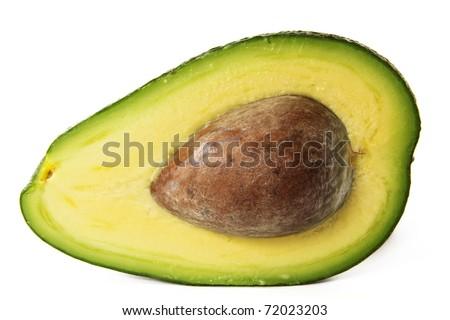 sliced green avokado half with seed - stock photo