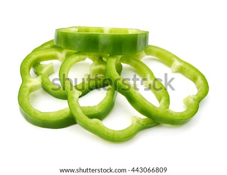 Sliced Green Peppers arranged on white background. - stock photo