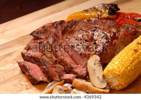 sliced grilled BBQ ribeye steak with vegetables