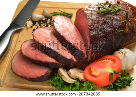Sliced grilled meat with vegetables on white background - stock photo