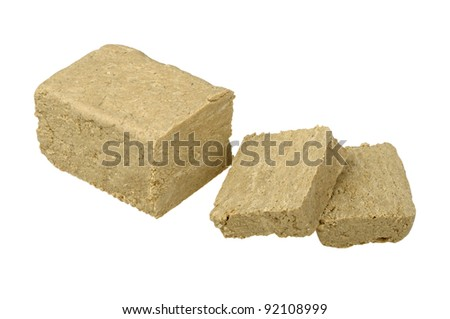 sliced halva isolated on a white background