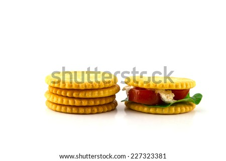 Sliced ham sandwich with tomatoes on a mixed seed bread - stock photo