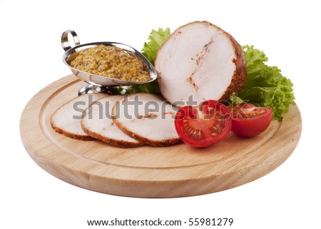 Sliced ham with mustard and vegatables on a wooden plate isolated