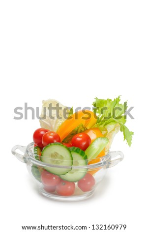 Sliced Healthy vegetables in a glass Plate - isolated on white background. studio shot