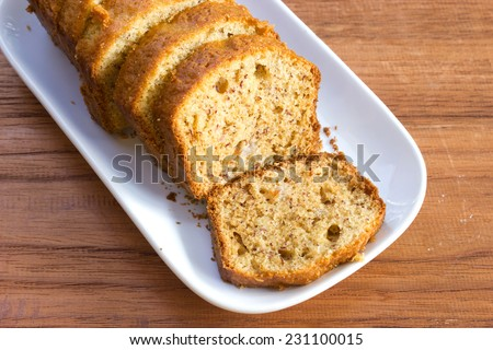 Sliced home made banana cake on white plate. Top view. - stock photo