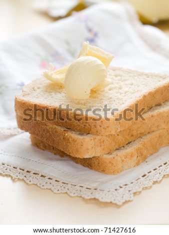 Sliced homemade brown bread with cereals - stock photo