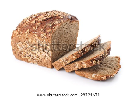 Sliced homemade brown bread with cereals. Isolated over white - stock photo